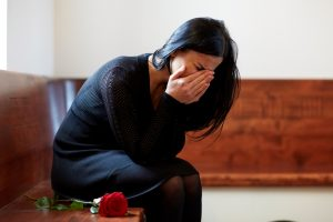 People,,Grief,And,Mourning,Concept,-,Crying,Woman,With,Red